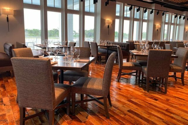 dining room at 34 Degrees North next to the large floor to ceiling windows of the waterfront